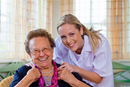 Happy senior citizen with nurse