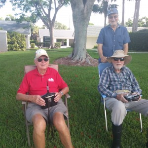 Two seniors with remote control boats