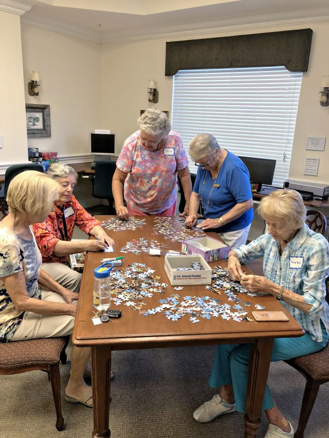 Senior ladies putting a puzzle together