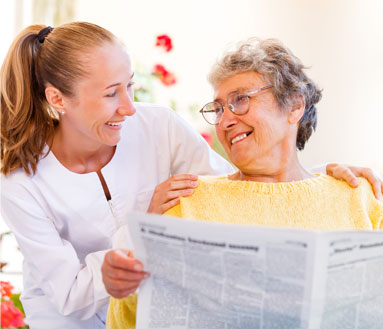 Senior citizen happily reading a newspaper