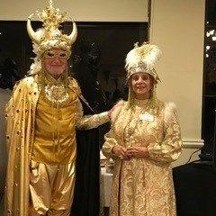 senior living couple dressed in gold