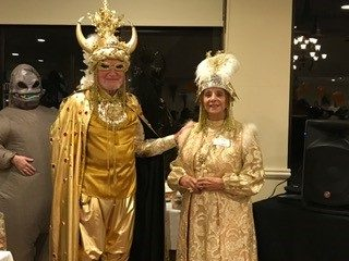 senior living couple dressed in gold