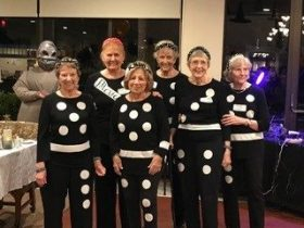 group dressed as dominos