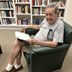 Arbor Trace resident reading a book