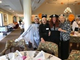 group of senior ladies at halloween party