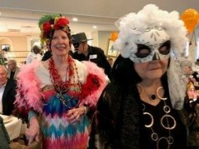 two senior ladies dressed in costume