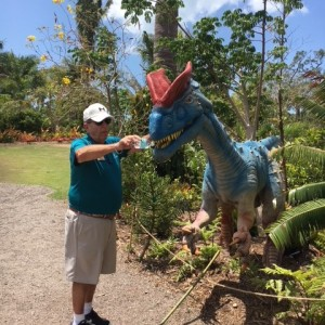 Man pretends to feed dinosaur