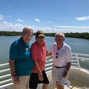 three senior men on a cruise
