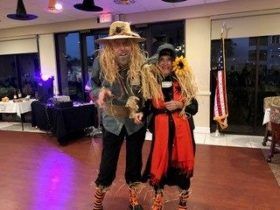 Couple dressed up as scarecrows