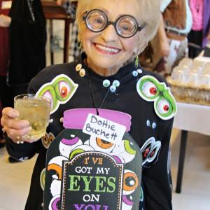 Senior lady wearing eyeball costume