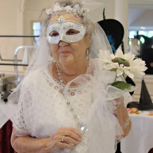 senor woman dressed up as bride
