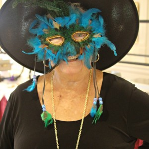 Lady wearing mask and witch hat