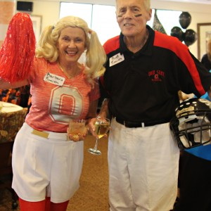 couple dress as football player and cheerleader