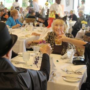 Senior living residents cheers at halloween