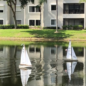 two remote controlled sail boats