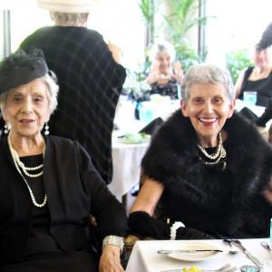 Senior ladies wearing black and pearls