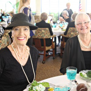 Two ladies wearing black oufits