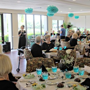 Woman speaks at ladies luncheon