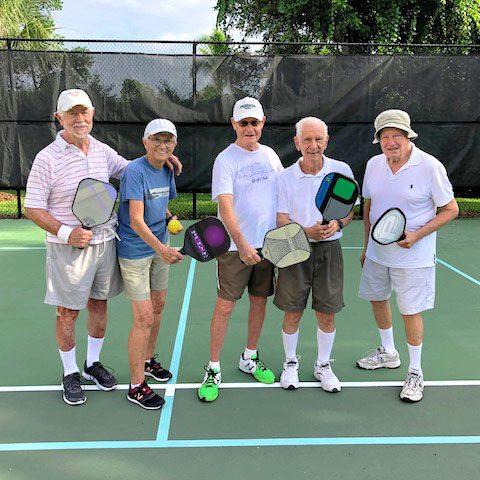 Seniors playing Pickleball at Arbor Trace