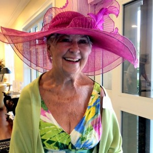 Woman wearing big pink hat