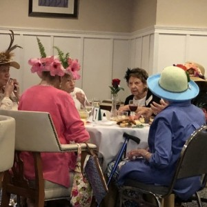 Group of ladies wearing hats at a table
