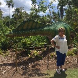 Senior lady in front of dinosaur