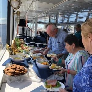 Seniors eating on cruise buffet