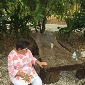 Woman sits at tree table