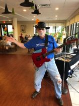 Man playing rock guitar at Arbor Trace