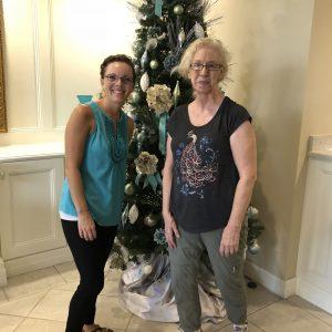 Arbor Trace lobby Christmas tree ladies