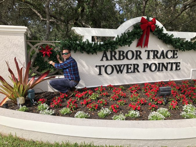 Arbor Trace front entrance being decorated