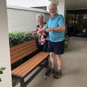 Senior residents hanging lights