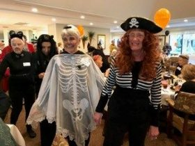 seniors dressed up like pirate and skeleton