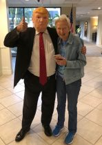 senior living staff dressed up as President Trump