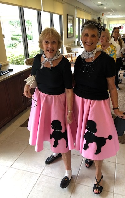 Two senior ladies in poodle skirts