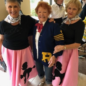 Senior living residents in poodle skirts