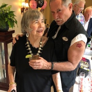 Senior woman and her son enjoying cocktails