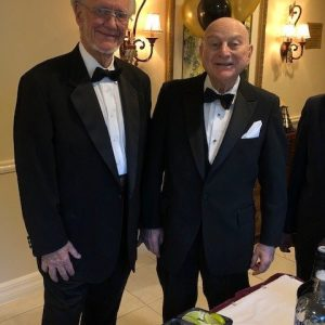 two senior men in tuxes