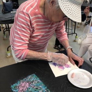 Arbor Trace resident works on art