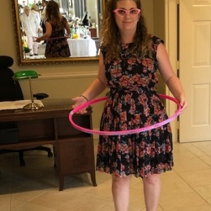 young girl hula hoops