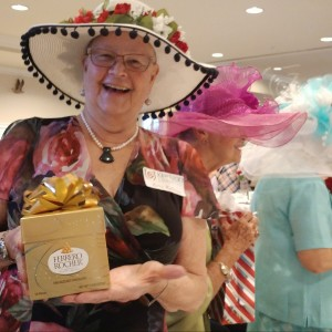 Woman wins gift at hat contest