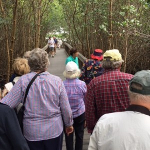 Senior living residents enjoy nature walk