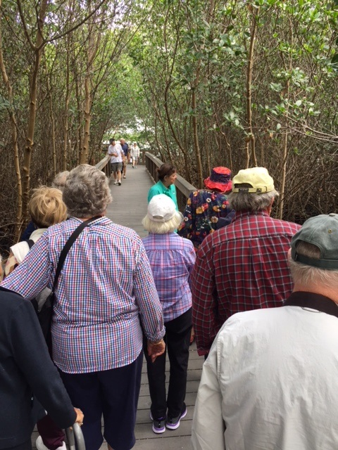 Senior living residents enjoy nature walk