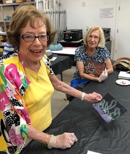 two ladies enjoy making art
