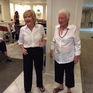 Two senior ladies lead chorus