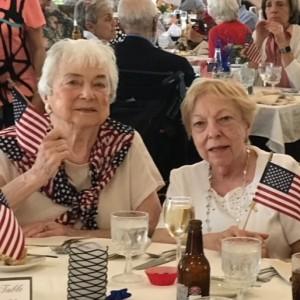 Senior ladies holding flags