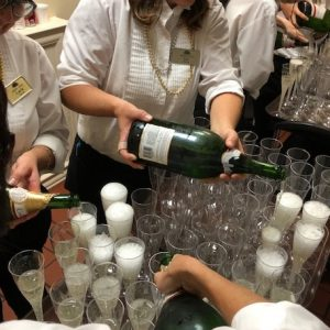 Pouring champagne for senior living community