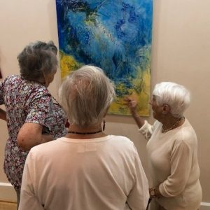 three ladies discussing art