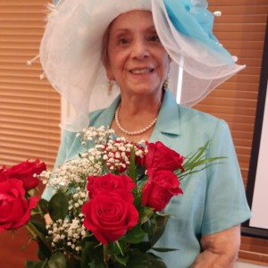 Senior woman holding winning roses