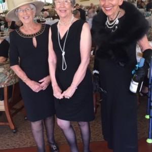 Three ladies dressed like breakfast at tiffanys